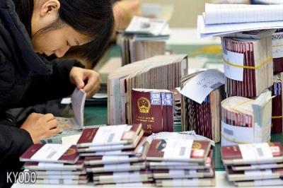 中国赴日游签证付费方式将调整 现金支付变为银行转账