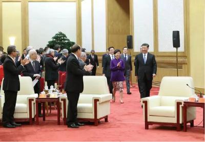 习近平:在国家改革开放中实现香港澳门更好发展