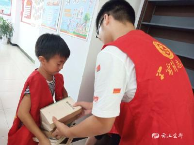 """【新时代文明实践在宜都】""""我给书籍来分类""""!锦江社区迎来小小志愿者"""