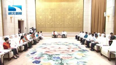 张富清同志先进事迹报告会在武汉举行 蒋超良王晓东出席报告会并会见报告团成员