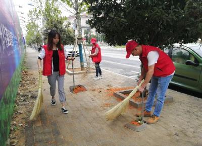英山县九昇城发集团积极开展创卫志愿服务活动