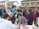 阳光雨社会工作服务中心联合市中医院开展健康扶贫义诊活动